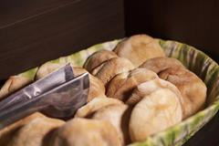 Basket filled with local traditional andean bread in Colca, Arequipa, Peru Stock Photos