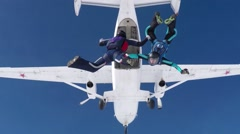 steam aerial acrobatics. jump out of a plane against the blue sky - stock footage