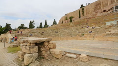Ruins of ancient theater on the slope of Acropolis, tourist attraction in Greece - stock footage