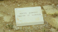 Greek and English inscription Theater of Dionysus on stone sign for tourists Stock Footage