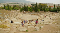 Time lapse of many visitors viewing remains of ancient Greek Theater of Dionysus Stock Footage
