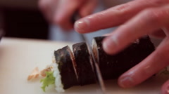 Chef in restaurant preparing and Cutting sushi rolls healthy food  Stock Footage
