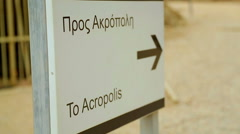 Information pointer arrow showing way to Acropolis, sightseeing trip, tourism Stock Footage