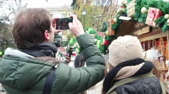 Couple make pictures of the Christmas fair and goes to the counter with souveni Stock Footage