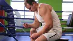 A man in the Boxing ring listening to music Stock Footage