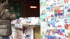 Stock Video Footage of Exhibition of children cards handmade Christmas market