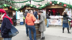 People at the Christmas fair are resting drink beer and communicate with Stock Footage