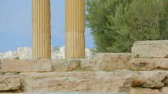 Vertical pan shot of ancient palace with tall marble columns, sightseeing tour Stock Footage