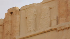 Remains of sculptured relief on ancient temple, cultural heritage preservation - stock footage