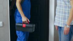 Stock Video Footage of The plumber came to the customer home