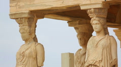 Huge marble female sculptures supporting entablature of ancient Greek palace Stock Footage