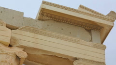 Ancient architecture design details, marble column supporting architrave remains Stock Footage