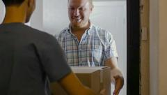 The courier gave a parcel to the customer Stock Footage