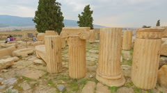 Stock Video Footage of Pieces of sophisticated marble columns piled on ground, ancient building ruins