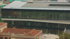 Panorama view of new Acropolis Museum, modern glass building, many tourists - stock footage
