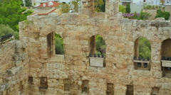 Panorama shot of facade detail at antique Odeon of Herodes Atticus in Athens Stock Footage