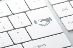 Business concept: Handshake on computer keyboard background Stock Illustration