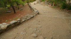 Ancient stony road through park to modern city, decaying old infrastructure Stock Footage
