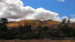 California Central Valley Hills sunny puffy cloud timelapse Stock Footage