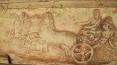 Antique marble stone relief showing chariot racers at ancient Panathenaic Games Stock Footage