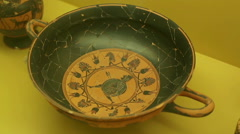 Black clay kylix with warrior, ancient Greek pottery art, Agora museum exhibit Stock Footage