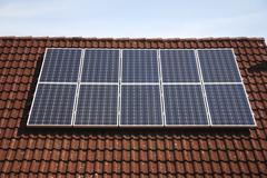 Stock Photo of Alternative energy with solar collectors on a house roof