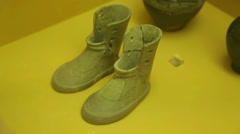 Stock Video Footage of Pair of miniature terracotta boots, ancient Greek offering from cremation burial