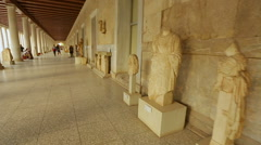 Timelapse of person viewing exhibits, statues at ancient Agora museum in Athens Stock Footage