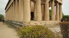 Vertical pan shot of ancient Temple of Hephaestus, Greek cultural heritage Stock Footage