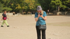 Female tourist checking online map on smartphone, woman lost in foreign city Stock Footage