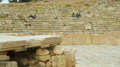 Stock Video Footage of Pan shot of amphitheatre seats at Dionysus Theatre, people having rest, walking