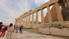 Happy young couple enjoying honeymoon trip to Greece, viewing ancient Parthenon Stock Footage