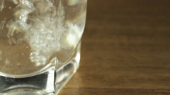 Glass of water on a table, macro Stock Footage