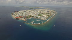 Aerial shot of crowded tropical island, overpopulation - Male, Maldives Island Stock Footage