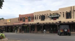 Pan of storefronts in historic Taos, New Mexico. Stock Footage