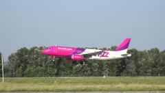 Wizz air airplane take off, from side view Stock Footage