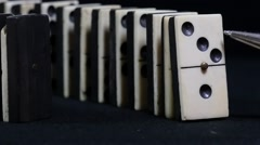 Stock Video Footage of downfall of dominoes in slow motion