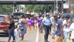 Magic New Orleans: Police Officer enjoying Katrina 10 Year Second Line Parade Stock Footage