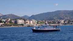 A motor boat in the sea in front of Genoa Stock Footage