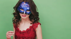 Sexy woman wearing masquerade mask at party - stock footage