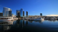 San Diego boats and skyline early morning Stock Footage