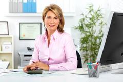 Beautiful mature business woman. Stock Photos