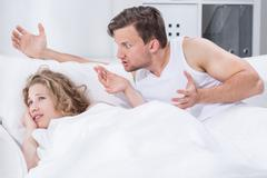 Argument in bed - stock photo