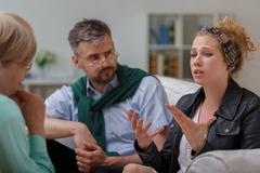 Counselor and couple with problem Stock Photos