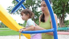 Child climbing up jungle gym - stock footage