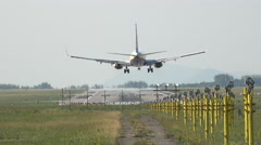 Airplane landing and touchdown with runway lights Stock Footage