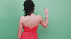 Young beautiful sexy girl drinking champagne in Venetian mask. Studio. Green Stock Footage