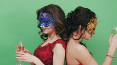 Stock Video Footage of Two young girls in sexual Venetian masks. Studio green background