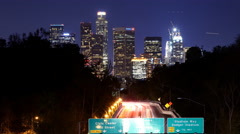 Stock Video Footage of Time Lapse of Urban Highway Traffic Light Streaks in LA at Night Skyline/Traffic
