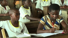 ADEISO CLASSROOM TWO GIRL STUDENTS Stock Footage
